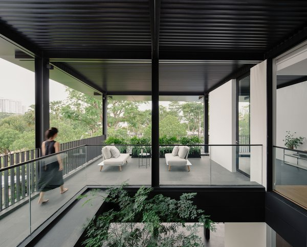 The second storey patio is accessed from the master bedroom via an internal corridor or from the common areas via an external bridge. Each route lets occupants engage with the first storey via the void.