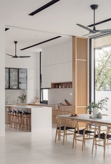 The white, light interior palette contrasts with the shell's dark tones.