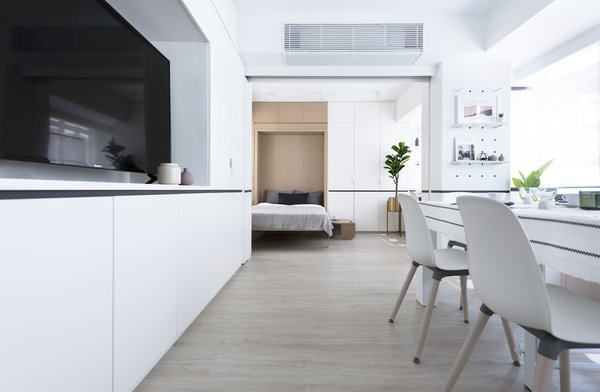 In the largest apartment, sliding pocket doors separate sleeping and living zones. The openness of the Bizhouse apartments also conveys a sense of luxury within space-scarce Hong Kong.