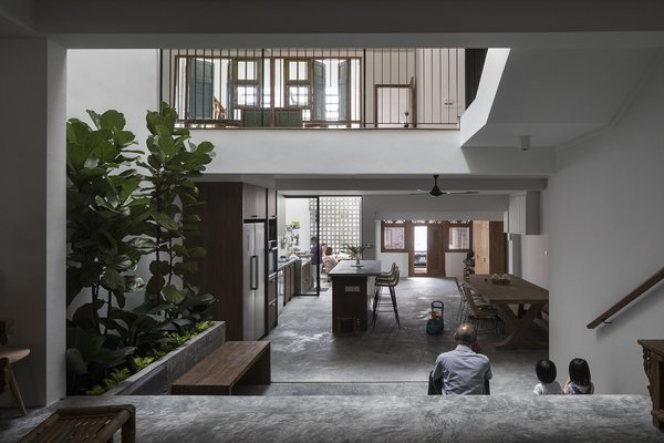 Light enters the long terrace house's plan via a new courtyard, which functions as a casual gathering spot between the kitchen, dining, and living rooms.
