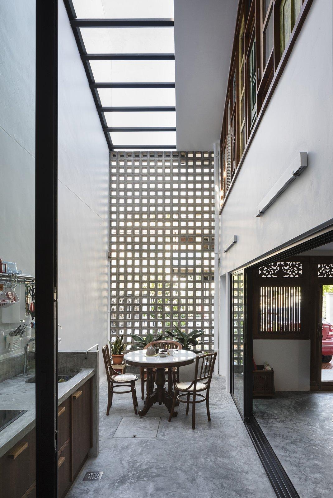 Heng House by Goy Architects, Tropical Living, Concrete Breezeblocks, Skylight, Upcycling, Timber Windows, Asian Kitchen