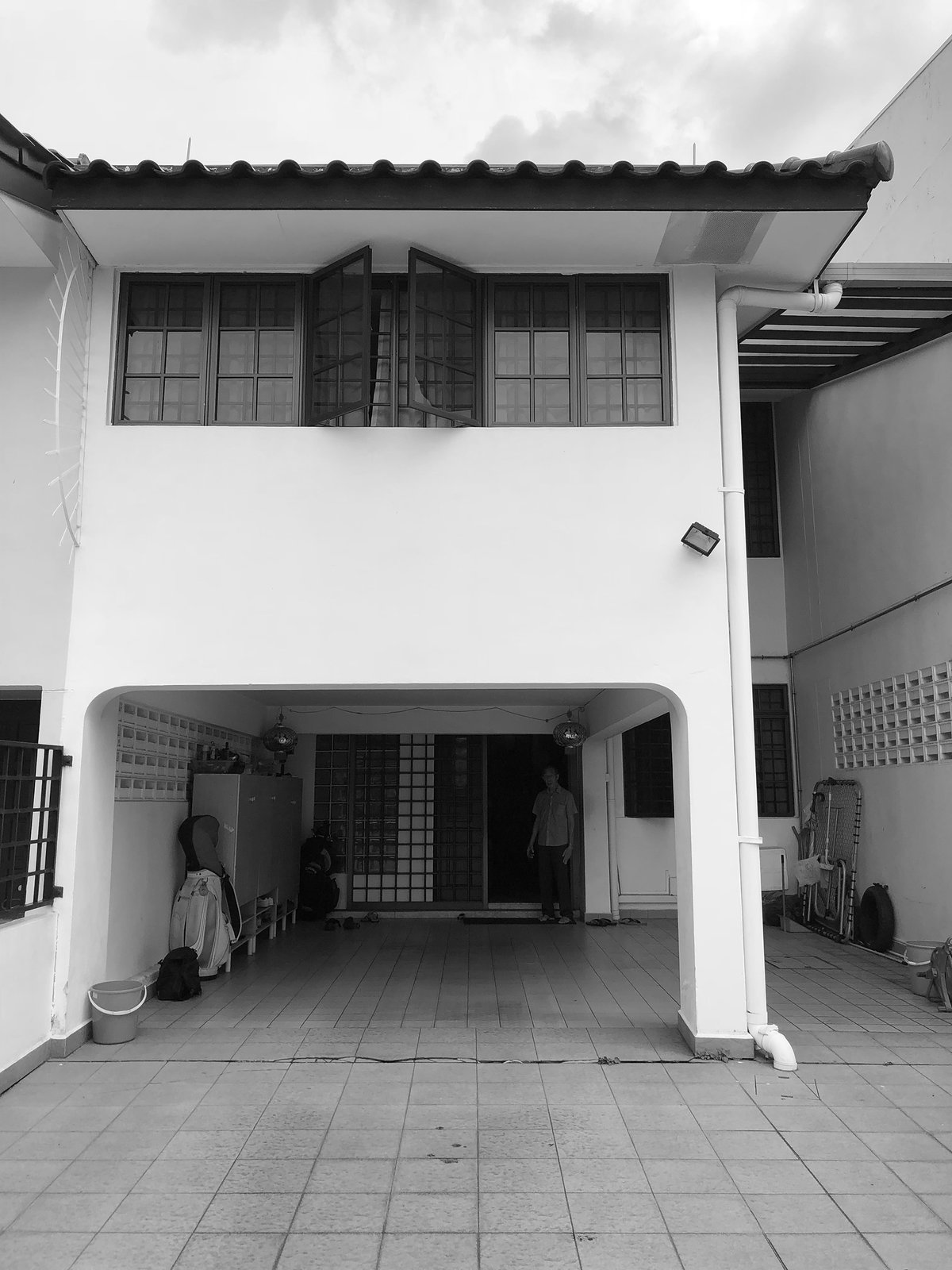 Before: The facade was closed off.  Photo 2 of 22 in An Imaginative Courtyard House in Singapore Makes Room for Multiple Generations