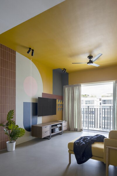 The spaces are cleanly defined by color blocking—as seen here in the canary-yellow living room.
