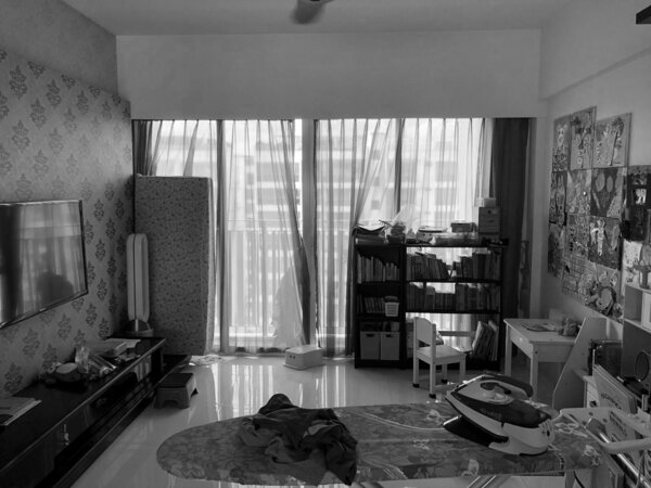 Before: The living room had gaudy wallpaper and polished tiled floors