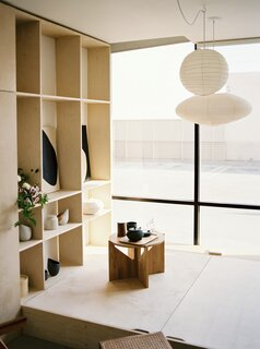 The open shelving displays ceramics and artwork by Fong Min Liao.