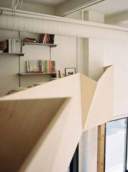 The staircase and handrail were assembled from 10 custom fabricated panels, angled to break up the visual continuity.
