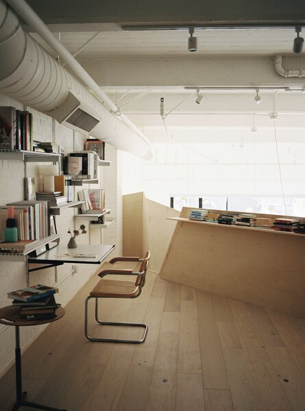The mezzanine was extended by 130 square feet and now holds a study organized by Rakks shelves.