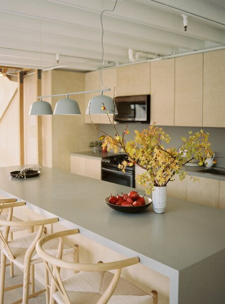 An Ambit Rail pendant lamp from Muuto lights up the new kitchen island, which allows more room for food preparation and seating.