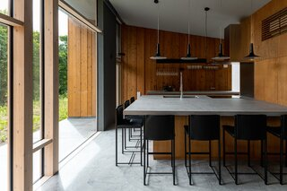 The kitchen-cum-dining is designed for both intimate meals and hosting friends in a casual setting.