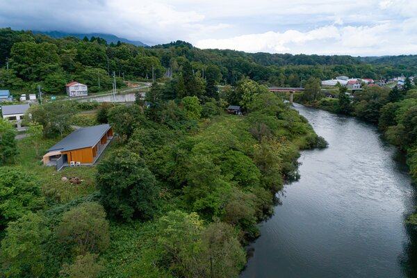 The terrace outside the common areas overlooks the picturesque Shiribetsu River.