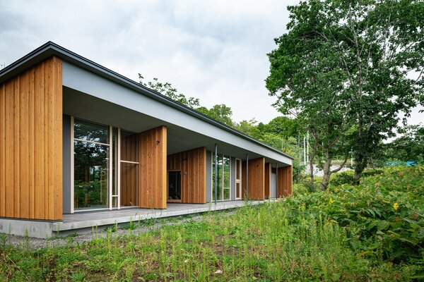 The house's short, east-facing walls extend out to the terrace, blurring indoor and outdoor spaces.
