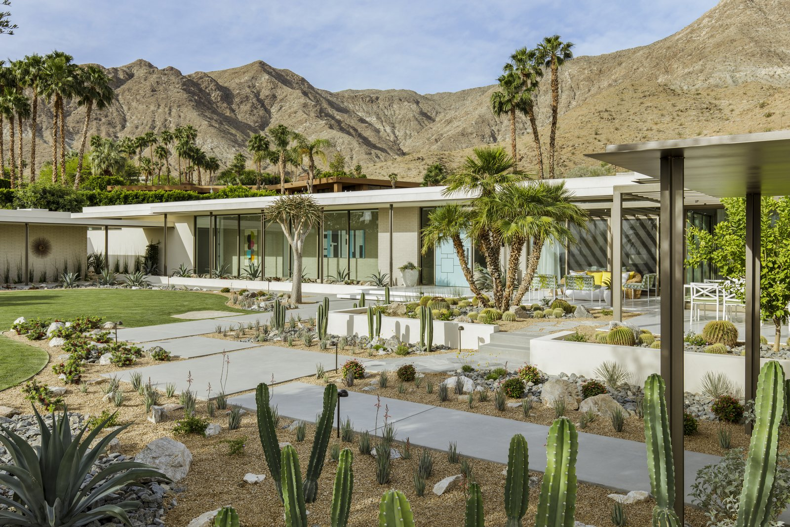 """Outdoor, Trees, Gardens, Walkways, Front Yard, Desert, and Hardscapes """"The client's goals were to create an open and light-filled home that maximized views of the Coachella Valley below and the Santa Rosa mountains to the south and west,"""" says designer Stuart Silk Architects. Thunderbird Heights Residence enjoys a fluid connection between the primary indoor rooms and the outdoor terraces both for entertaining and casual outdoor living.  Outdoor Desert Photos from Thunderbird Heights Residence"""