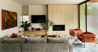 Interior designer Laura Britt followed WELL Building Standards to source the home's non-toxic furnishings and finishes, which include living room chairs and a sofa from Thayer Coggin that use flame retardant– and formaldehyde-free cushions.