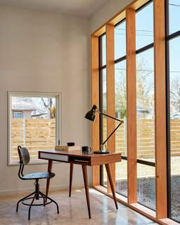 The guest suite features a custom steel-and-Douglas fir window system facing the courtyard. The 180-square-foot space has its own bathroom and entrance, allowing it to function as a guest suite, mother-in-law space, or detached office.