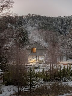 A Chilean Cabin Rises Amidst Ancient Trees in the Andes Mountains