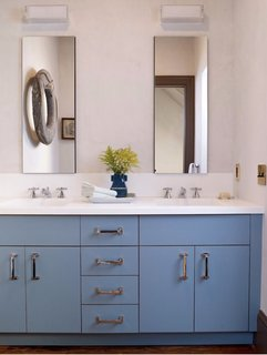 My boys' bathroom is one of my faves, as I love the color of the blue cabinets. And no, it rarely looks this pristine.