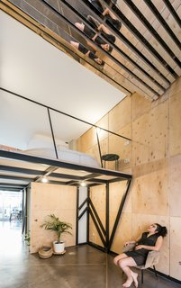 """Natural light floods the studio through a large window and is reflected into the mezzanine level via the mirrored """"vault."""""""