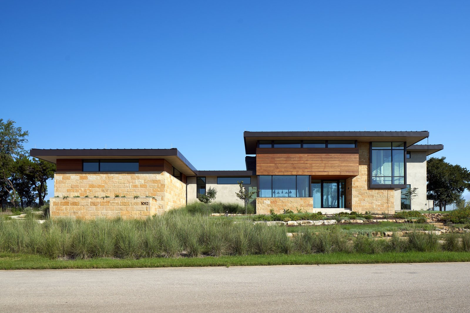 Exterior, Hipped, Stucco, Metal, Wood, Gable, House, and Stone Lago Vista by Dick Clark + Associates  Exterior Hipped Photos from Lago Vista