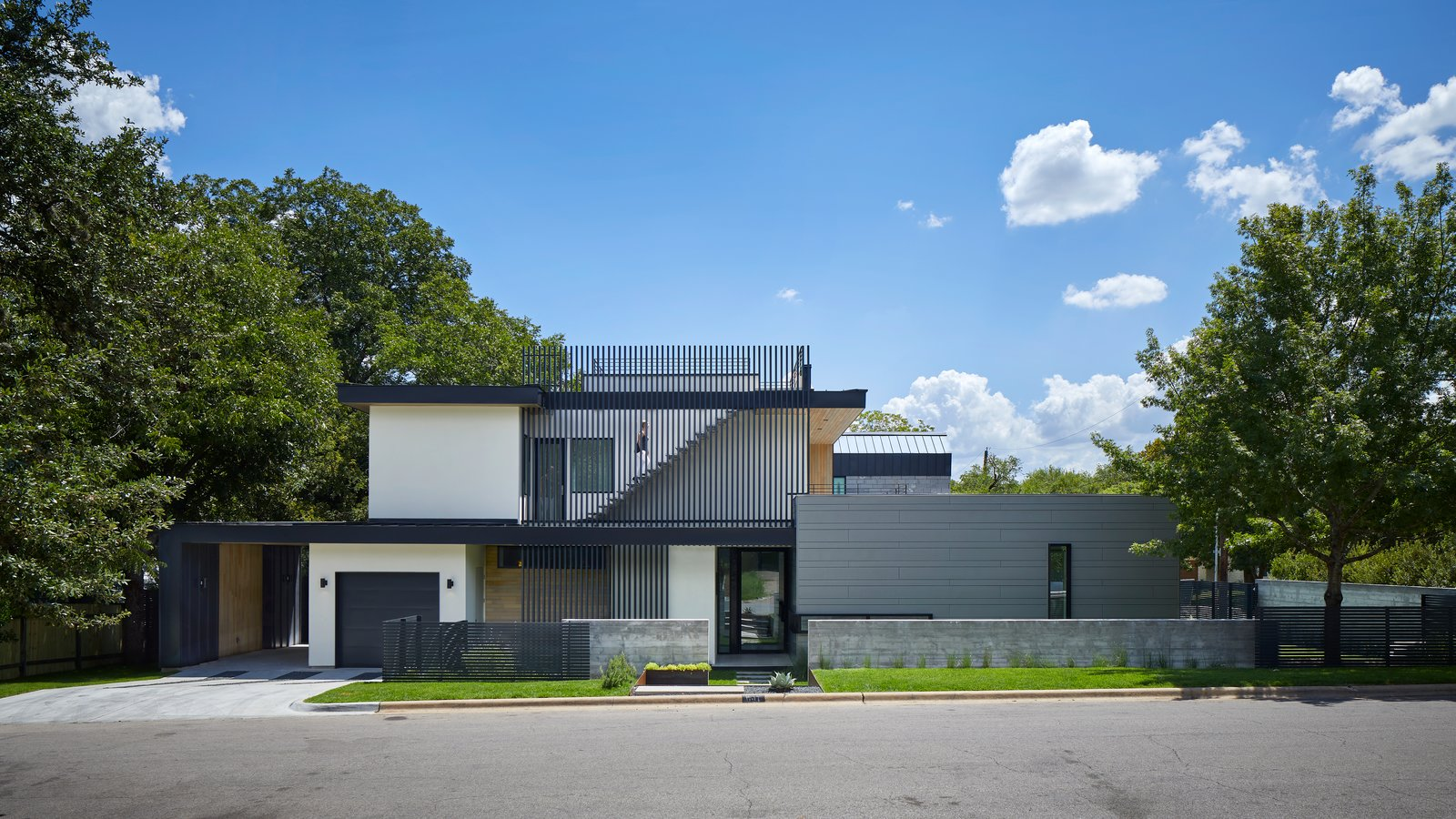 Exterior, Stucco, Hipped, Metal, Flat, Metal, House, Concrete, Glass, and Wood 007 House by Dick Clark + Associates  Exterior Flat Wood Hipped Photos from 007 House