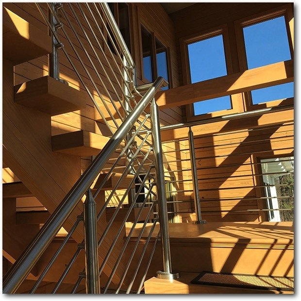 Staircase, Wood Tread, and Metal Railing Stairs in the Sunspace, Meridian  Meridian by Enertia Building Systems Inc.
