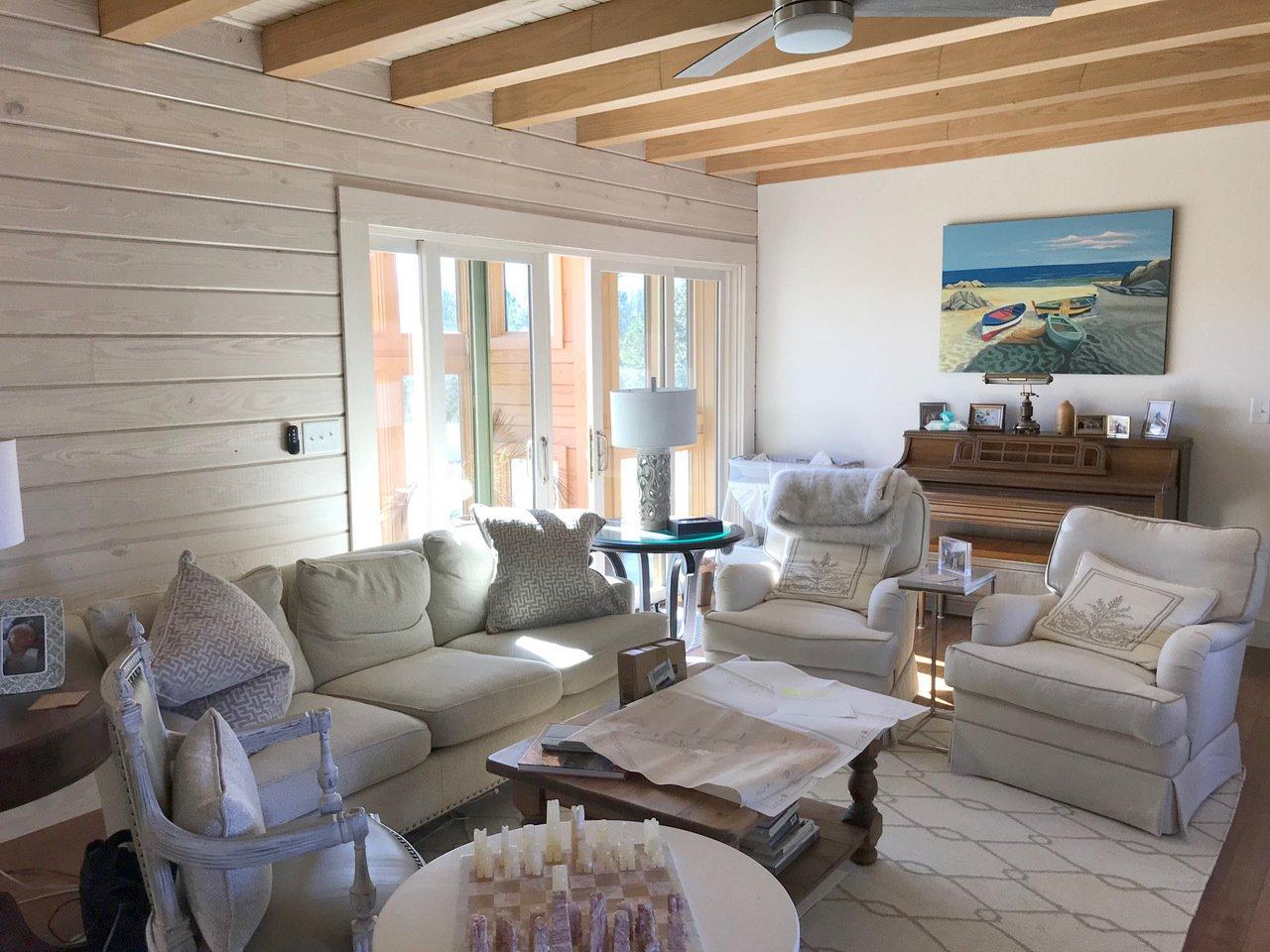 Living Room, Recliner, Ceiling Lighting, and Medium Hardwood Floor Living Room, Meridian by Enertia®  Meridian by Enertia Building Systems Inc.
