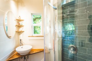 A Hawaiian mango wood counter and shelving add texture and warmth in the bathroom.
