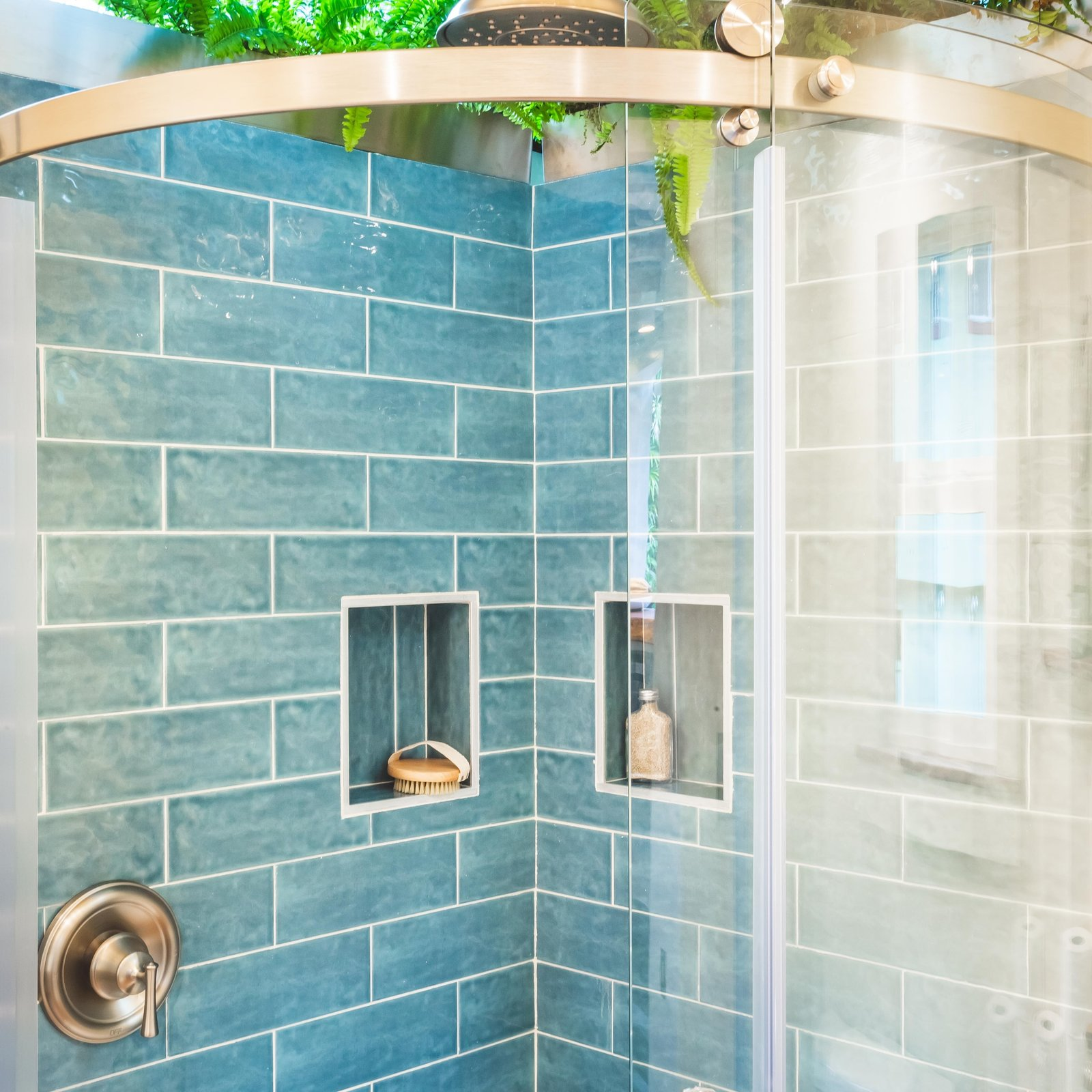 Oasis Tiny Home blue-tiled shower with skylight