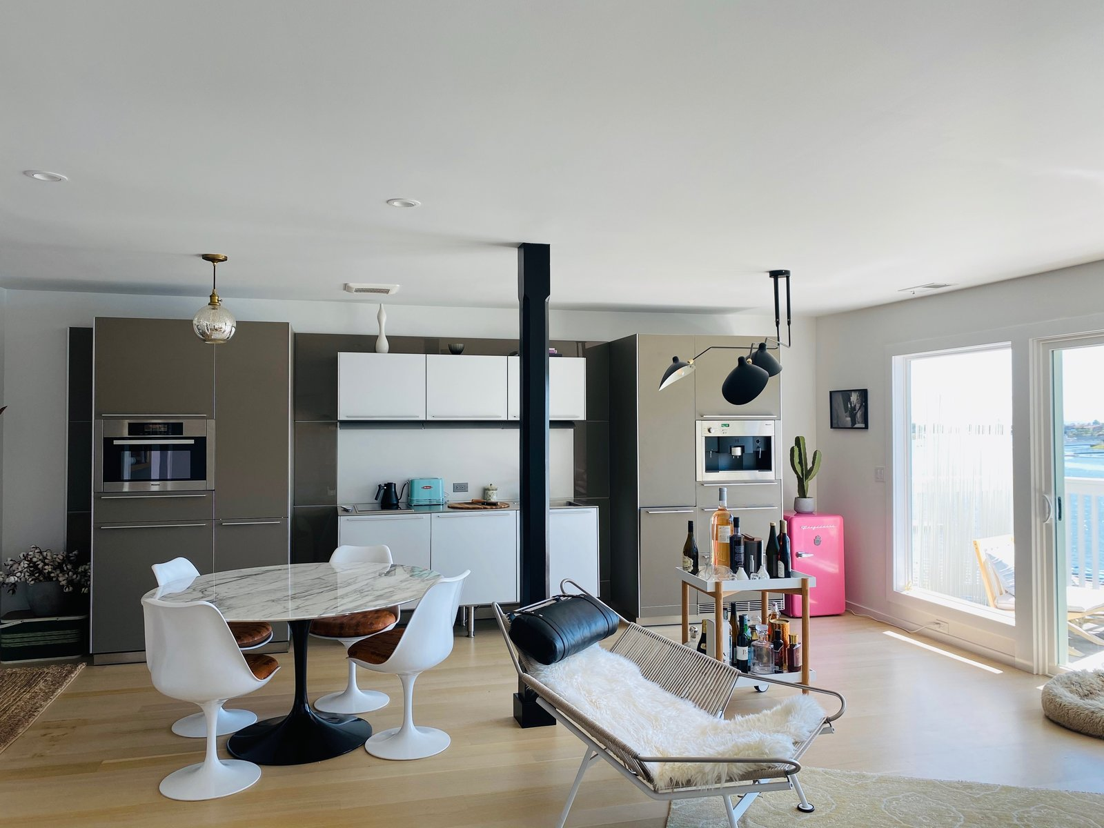 Dominique Crenn's Bay Area home is oriented to leave an unobstructed view of the water. The kitchen is minimal, with a simple oven and stove top with a small refrigerator and freezer tucked into the wall.  Photo 2 of 13 in 5 Comforting Dishes That Top Chefs Are Making at Home