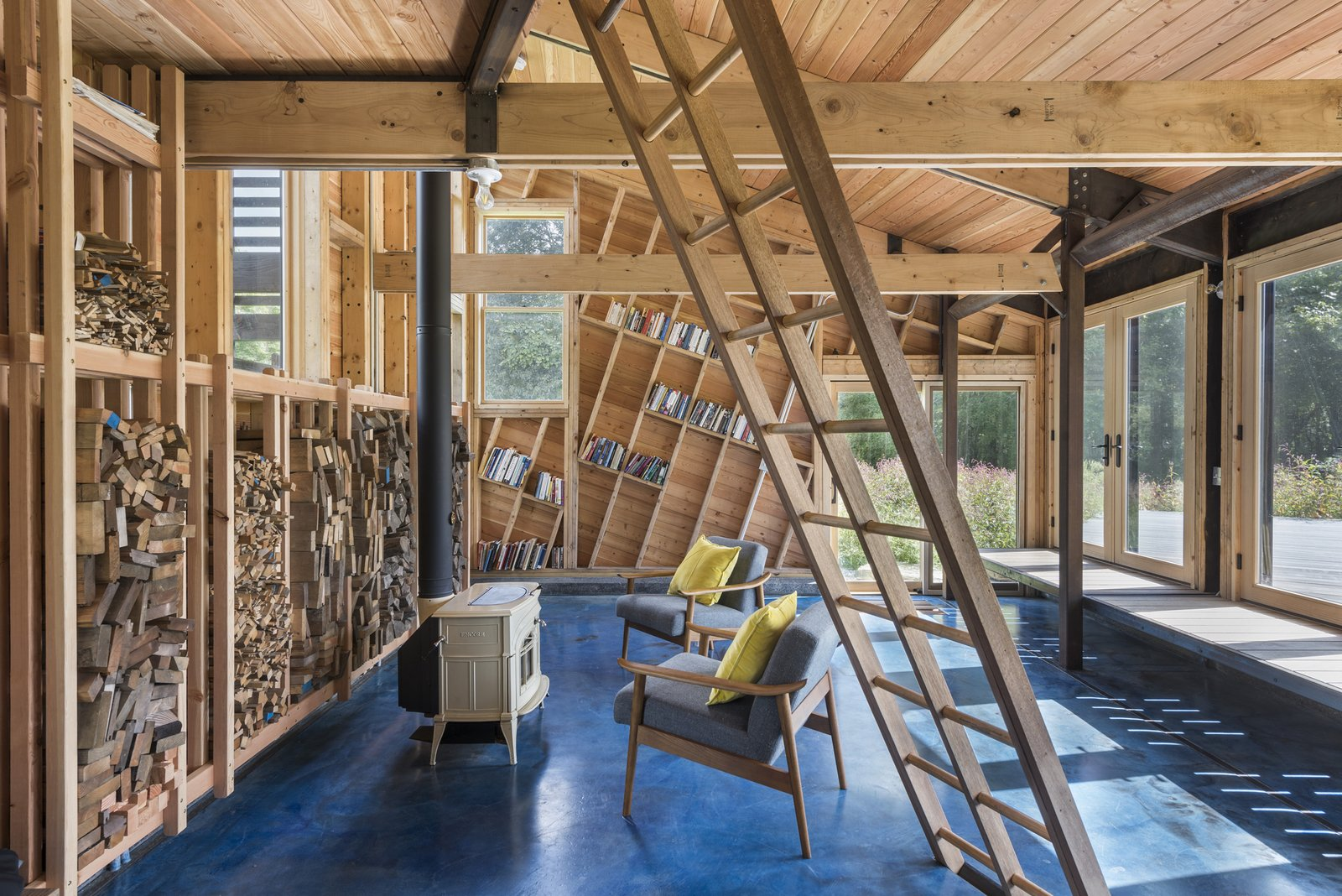 Douglas fir boards follow the angle of the roof, exaggerating the cabin's form.