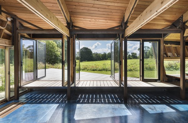 The bench extends beyond French doors onto a deck, blurring the line between outside and in.