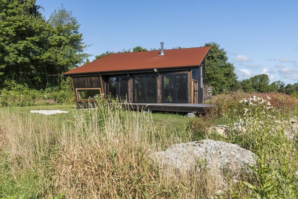 The architect sited the cabin not far from a puddingstone on the property.