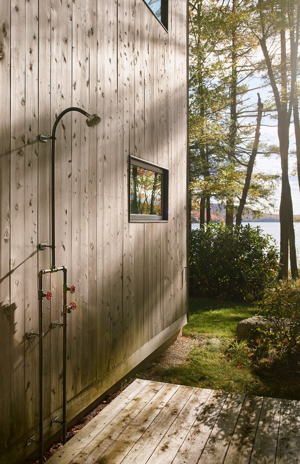 New Hampshire Lake Cabin by KCS Architects outdoor shower