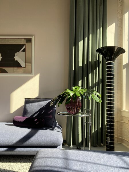 A piece by contemporary Japanese artist Hisashi Otsuka hangs above the Ligne Roset sofa. The black Lucite Optique floor lamp hails from the 1980s.