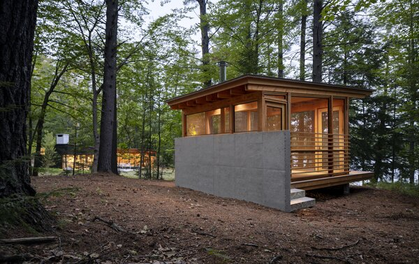 """Lane also designed a detached screen porch for the property. Its orientation captures the view of a small mountain across the lake. """"A New Hampshire lake house always has a screened porch,"""" he says. """"This one allows for a separate experience that connects you to nature."""""""