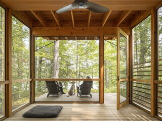 """""""Friends can use the screened porch for the day, like a cabana,"""" the wife says. The couple are also planning for teachers from High Meadow Farm to hold practices here. """"People will be able to use the porch and have access to the lake while our family is also using the house,"""" the husband adds."""