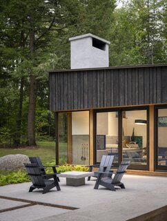 The owners built the house as a place to gather with their three adult children on Loon Lake, where they had vacationed at the husband's family home for years. The modern Adirondack chairs are by Loll Design.