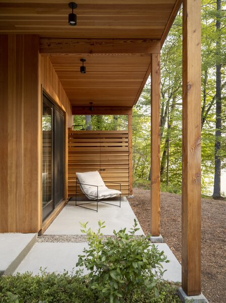 """We designed the landscape and house in tandem to ensure continuity between the exterior and interior,"" diNiord says. An outdoor sling chair by Croft House sits in front of the outdoor shower under the covered patio in front of the primary bedroom."