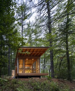 The detached screened porch sits out in the landscape, not unlike a Japanese teahouse.