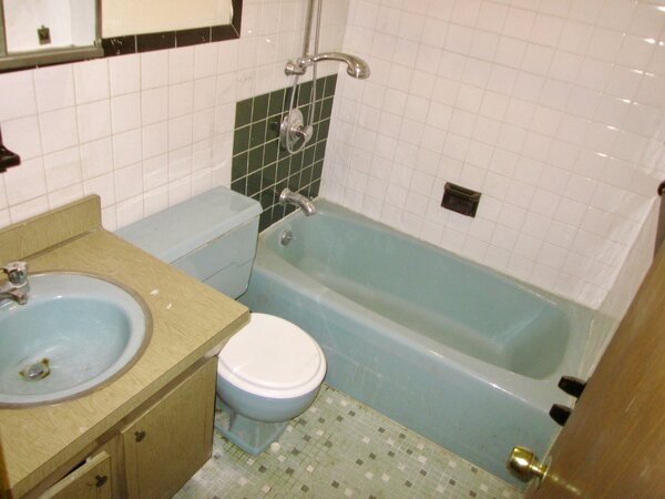The team demolished the powder blue bath on the first floor and added a new bath in the basement.