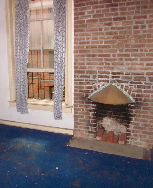 The team refurbished the chimney in the front portion of the house because Priscilla really wanted a fireplace.