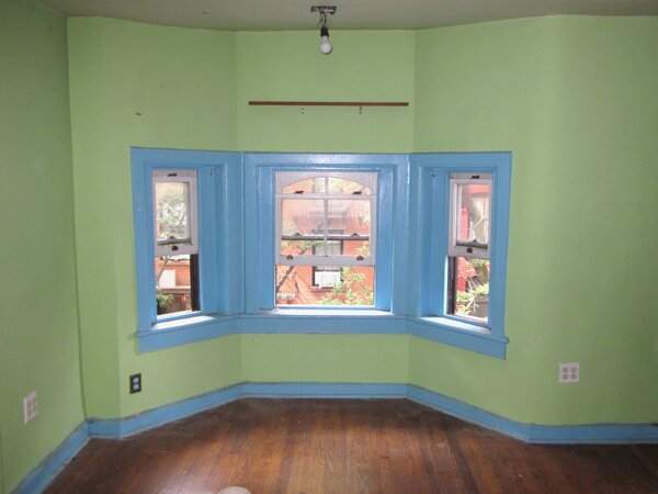 The front bedroom on the third floor sported quite the color combination.