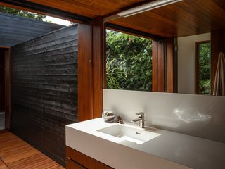 A private outdoor space connects the master bathroom with the home gym. The residence has TOTO fixtures (including Neorest Japanese toilets) and a property-wide water filtration system.