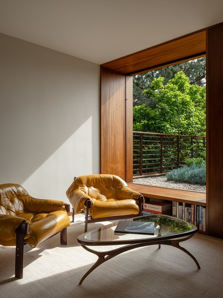 Sliding pocket doors connect the space to the rooftop garden.