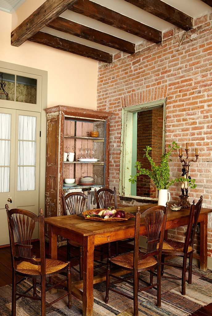 Dining Room, Chair, Table Lighting, Table, Medium Hardwood Floor, Storage, and Ceiling Lighting For the rare moments when you're not out enjoying New Orlean's amazing restaurants.   Antoine Bordeaux House
