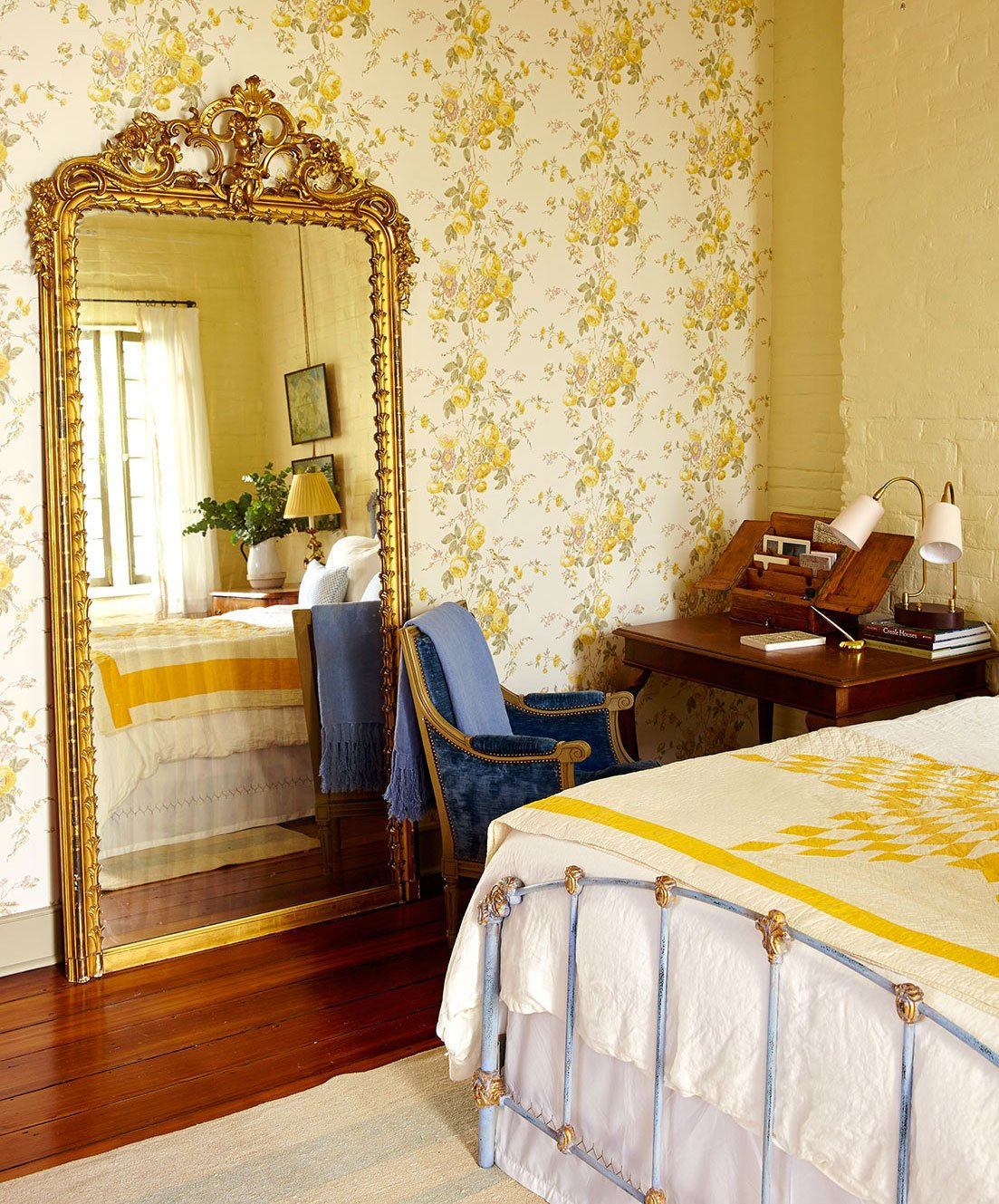 Bedroom, Dresser, Bed, Wardrobe, Medium Hardwood Floor, Ceiling Lighting, and Table Lighting New Orlean's style antiques throughout the home.  Antoine Bordeaux House