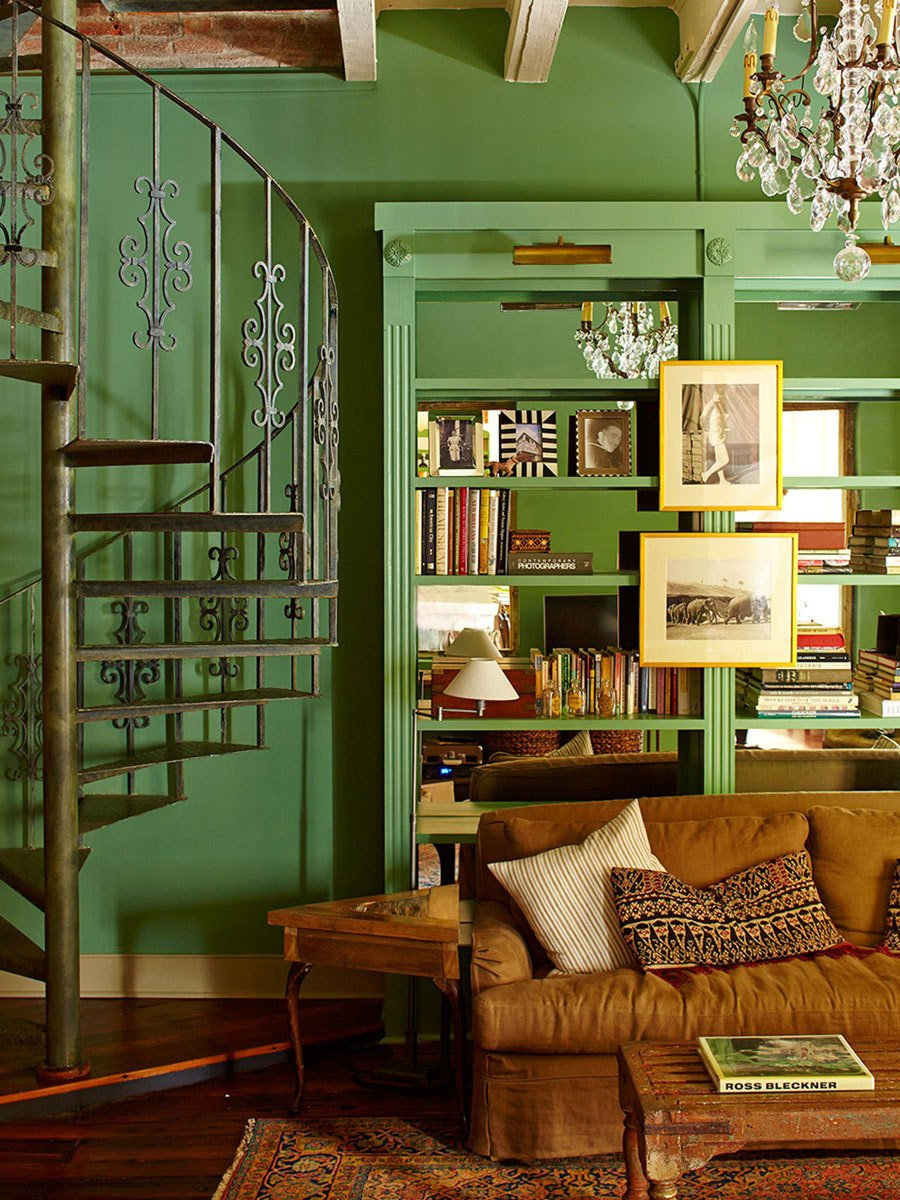 Living Room, Table Lighting, Sofa, End Tables, Coffee Tables, Bookcase, Ceiling Lighting, Chair, and Medium Hardwood Floor Vibrant green sitting room with spiral staircase to the upstairs bedroom.  Antoine Bordeaux House