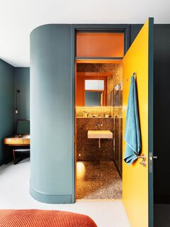ROAR Architects updated a former women's refuge in London's Kentish Town Conservation Area into two interconnected flats for a brother-and-sister duo. Housed in a historic Victorian, each of the flats have their own entrance. The interiors are also differentiated by their distinct color palettes and materials, which the architects designed to reflect the personality of each sibling.