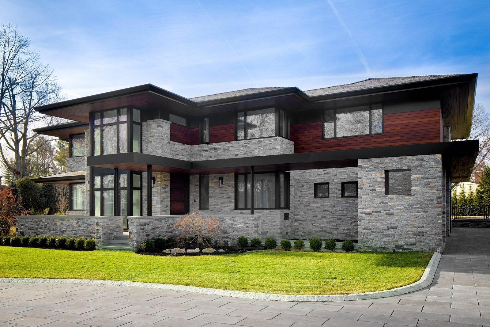 Exterior, House Building Type, Hipped RoofLine, Wood Siding Material, Stone Siding Material, and Shingles Roof Material Front Exterior  The Manhasset House by Node Architecture, Engineering, Consulting P.C.