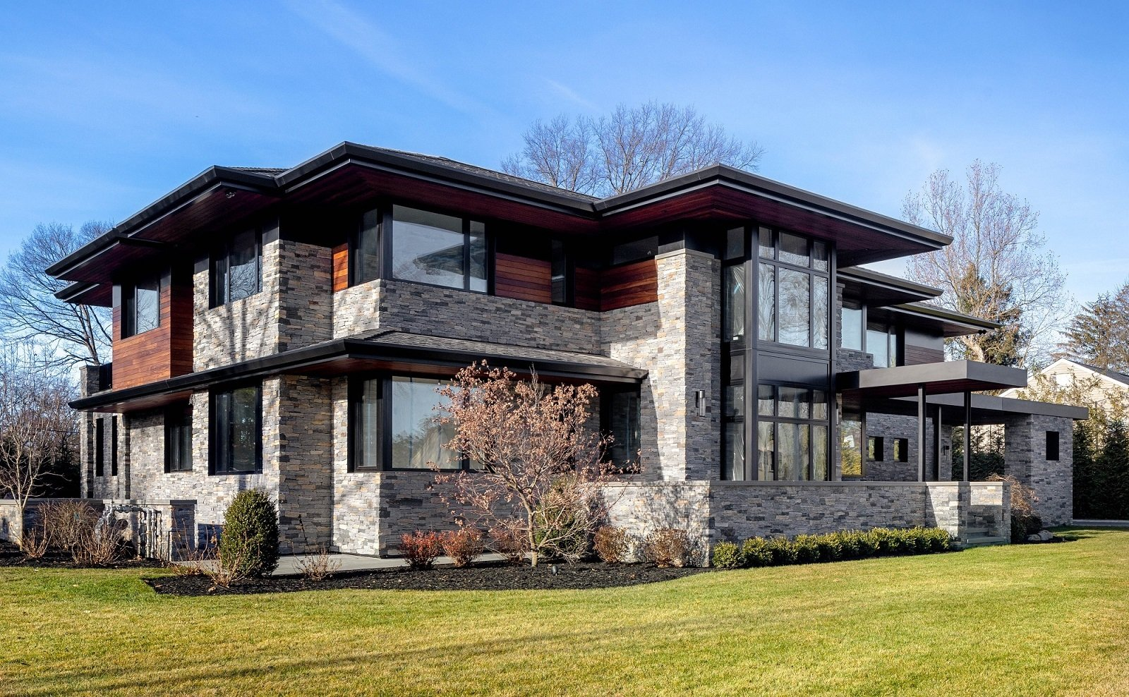 Exterior, Hipped RoofLine, Shingles Roof Material, Stone Siding Material, Wood Siding Material, and House Building Type Front Exterior  The Manhasset House by Node Architecture, Engineering, Consulting P.C.