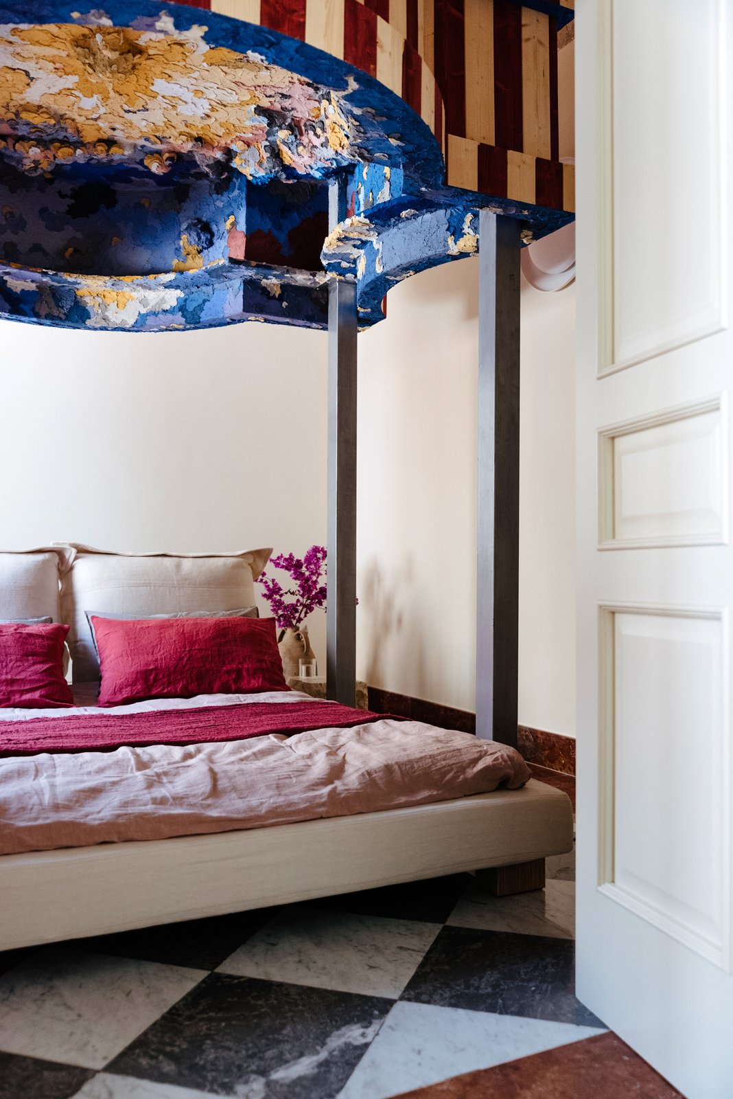 Bedroom, Bed, and Ceramic Tile Floor The four-poster bed was also customized by Piermattei.  Photo 20 of 20 in Italian Ghost Towns Are Turning Abandoned Buildings Into Alluring Airbnbs from Design apartments in Italian ghost towns